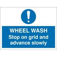 Wheel Wash Stop On Grid And Advance Slowly Signs